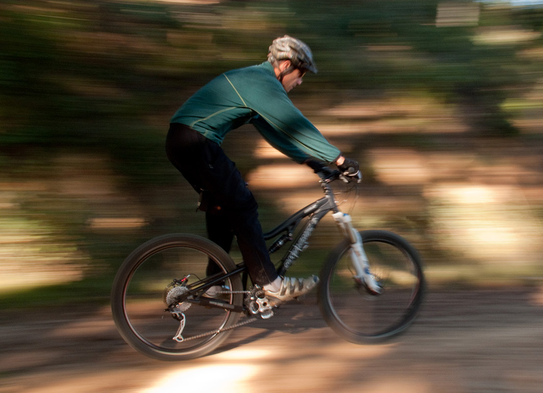 This subject in this image was moving at less than 10 mph (his top speed). The shutter speed was 1/15th second. Notice there's less detail in the rider, and the bike.