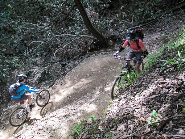 Emma and Heidi negotiate a switchback turn like old pros.