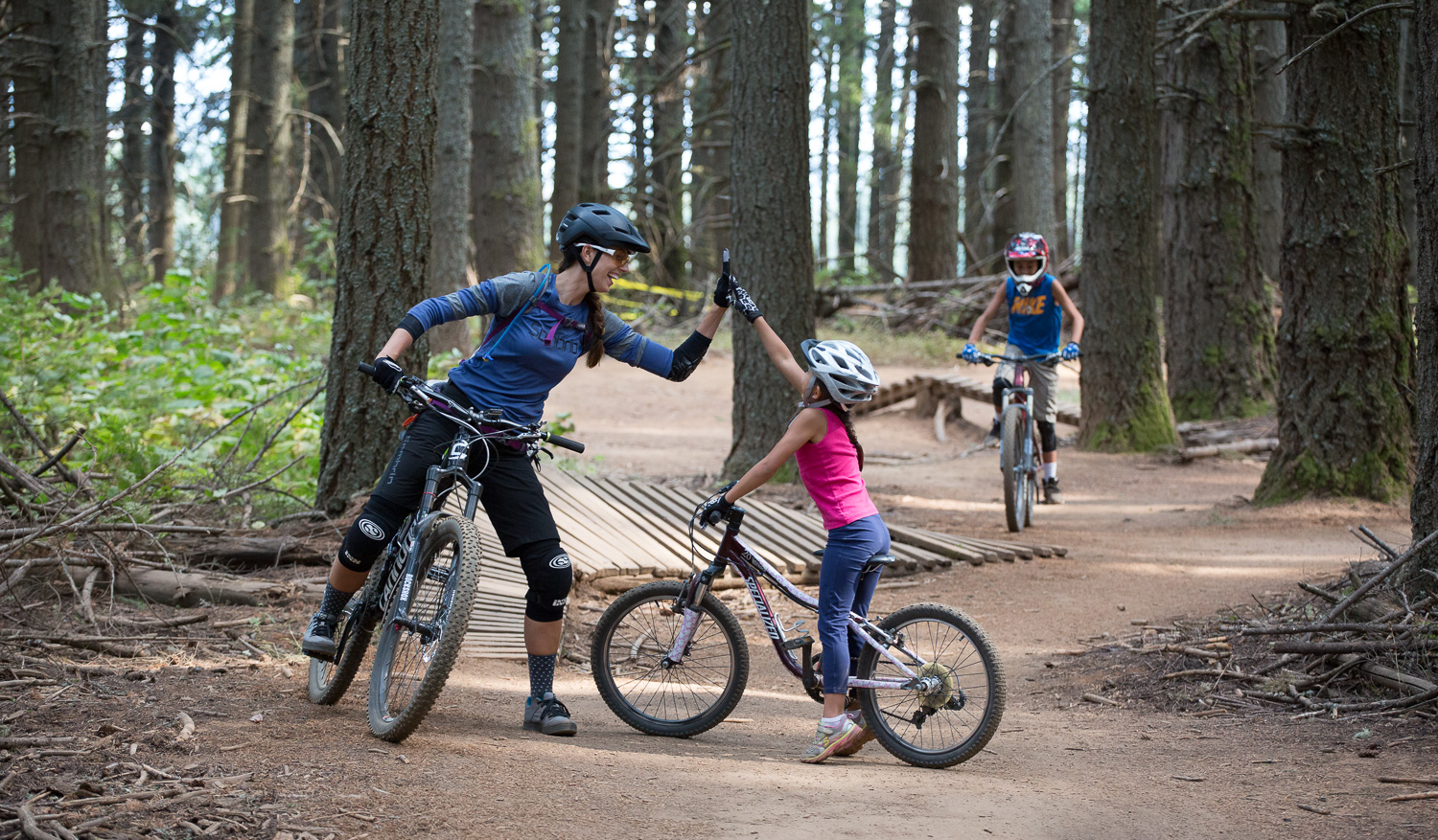 Hi-fives at the Family Man Skills Area at Post Canyon in Hood River, Oregon.